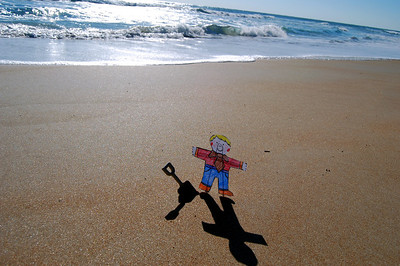 009 Flat Stanley playing in the sand on Daytona Beach