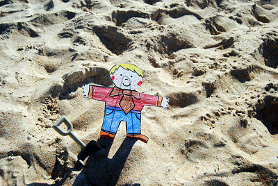 008 Flat Stanley playing in the sand on Daytona Beach