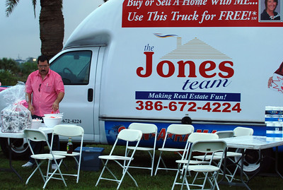 003 VIP Printing and Jones Realty booth with Roger at Making Strides Walk Daytona Beach