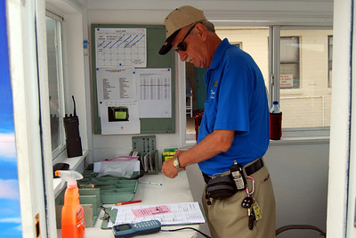 23 Bob the Beach Toll Taker doing his paperwork