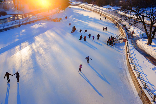 Late day skaters gliding into the golden light created by the seting sun.