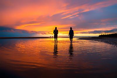 Enjoying a stroll on PEI sand bars at sunset