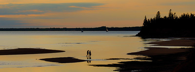 Walking on exposed sand bars on McCallum's Point,  outside of Summerside Harbour