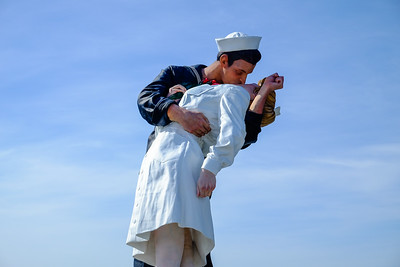 Unconditional Surrender Statue beside the USS Midway