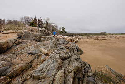 Jess taking photo from a rock formation, Mile Beach, Reid State Park, Maine
