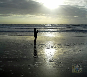 This is me on the beach, in the morning wearing a sweatshirt (it was cold!!) doing what I do best......taking pictures!  My wonderful hubby took this pic with his phone! Not Bad, Huh?