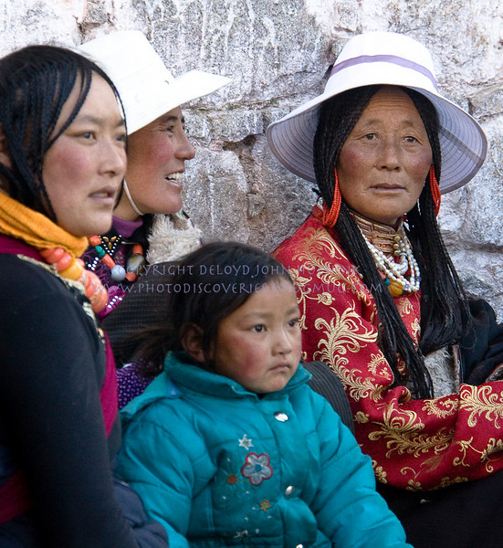 FAMILY RESEMBLANCE<br /> This is a Tibetan family in Lhasa, just outside of the temple.  I was struck by how much their facial features look like American Indians.  Think about the land bridge that once joined our continents.