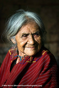This is Paulina. She is an 89 year old Mayan woman living on the shores of Lake Atitlan, in the Guatemalan highlands. Paulina is about 4 feet tall, lives in a one room hut that can be reached only by boat, then about 200 vertical feet of limited trail. She lives with her chicken. She has no running water, no electricity, and a blanket for the door. Her hut has only a dirt floor. She had lived there happily for years. Paulina speaks no English or Spanish. Only Mayan, of which our guide spoke only a few words. But we still felt we were able to communicate with her. When we visited Paulina she was cooking soup or tea over a small fire in the middle of her hut. It is unlikely Paulina had ever traveled beyond the shores of Lake Atitlan.  F2.2, 1/60, ISO500, ambient light