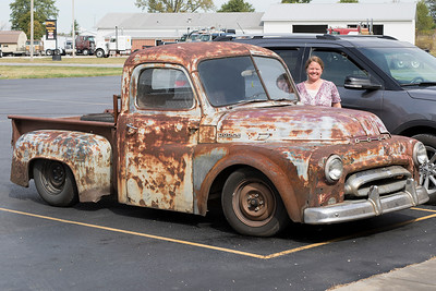 "Owner with her 1952 Dodge Truck.  ""We once sold this truck to a guy in Louisville and four years later purchased it back from him for $1,500.  We drove it to Florida and back last year.  This truck even has a hitch for a trailer.  My husband hauls his dirt-bike to Gatlinburg all the time.  This weekend we are taking it and a trailer to Chicago.  People ask us all the time 'Why don't you paint it' , but we like it jus the way it is.  This way we don't have to worry about chipping the paint when we drive down the gravel roads.""  Photographed in Orleans, Indiana, September 28th."
