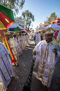 Long lines of well dressed celebrants marched through the streets