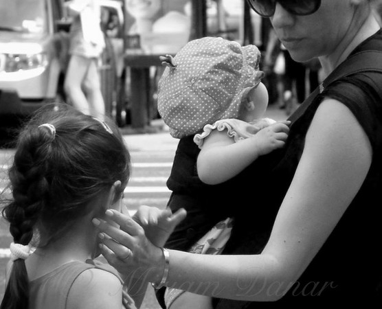 A Tender Moment - Mother and Child - New York City Street Scene
