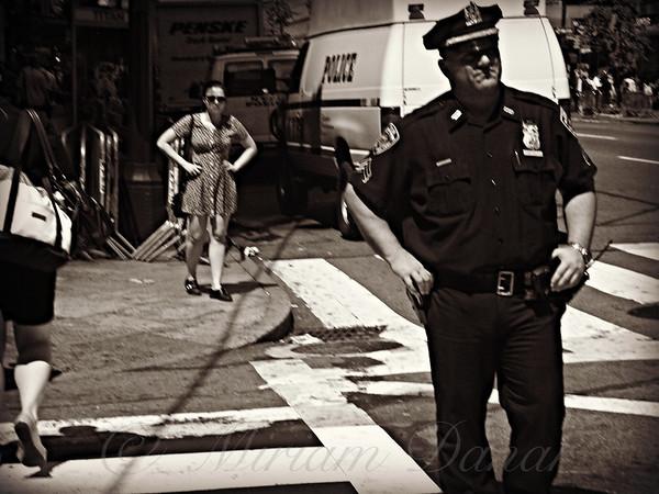 Girl and Policeman - New York City Street Scene