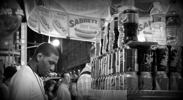Young Man with Food Cart - Times Square New York - Black and white version