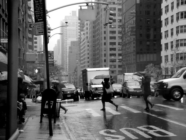 Running in the Rain - New York City Street Scene