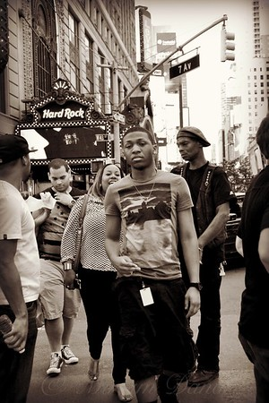Young Man and Guy with Cap - Times Square - New York