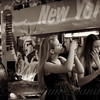 Two Girls with iPhones and Tour Bus - Times Square - New York