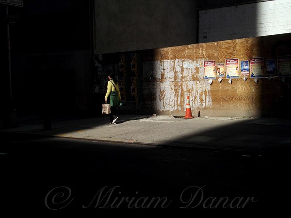 Girl Walking Into Shadow - New York City Street Scene