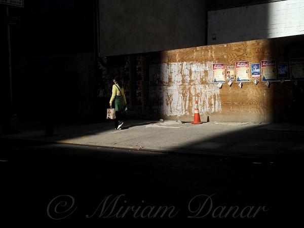 Girl Walking Into Shadow - New York City Street Scene