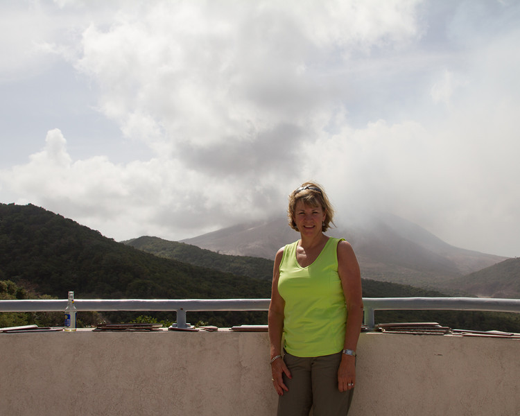 At the Montserrat Volcano Observatory with the Soufriere volcano in the background.