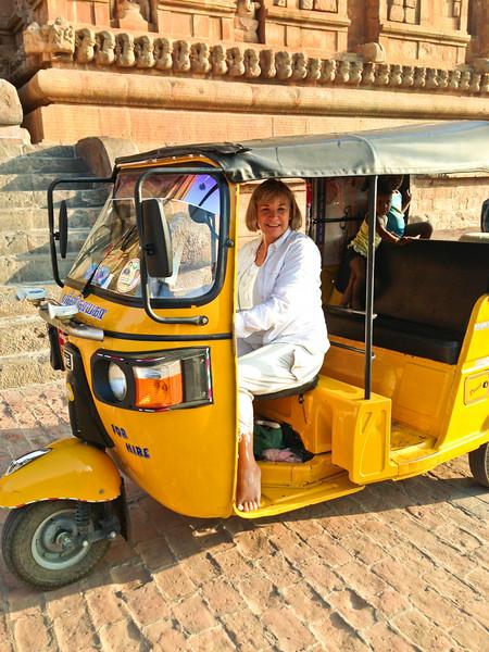 Debi driving a Tok-Tok