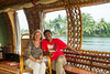 Debi and Bhaskar on luxury houseboat in Kerala, India.