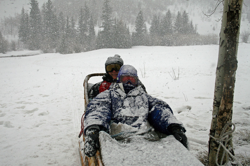 Covered in snow, Dogsledding in Colorado with Chris.