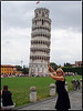 Holding up the Leaning Tower of Pisa.