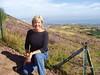 Debi climbing Arthur's Seat over Edinburgh