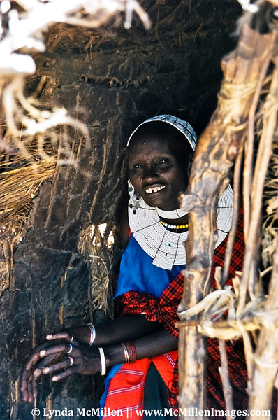 Masai mother in stick-and-mud hut, Tanzania