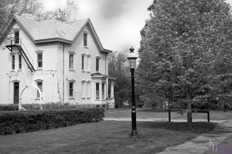 I don't know which shot I preferred on this cloudy day, the one I left in color or this one that I converted to black and white. But as for the scene itself, I just love this old Governor's mansion, one of the many old architectural treasures here at Snug Harbor.