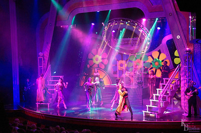 Traveling to Bermuda on our cruise ship in the fall of 09', I went hunting for some of the girls in our group who said they were going to take in the after dinner show taking place in the main auditorium. I didn't spot any of them when I got there, but I did get this nice shot of the main act on stage.