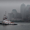 A grey hazzy day in the city created just the monotone scenic look I've been longing to capture behind a colorful passing tug. This tug wasn't all that colorful as I wanted, but it worked. Now all I'm waiting for is a foggy day shot of a tug, with a wide sweeping NYC background as a great mood setting backdrop.