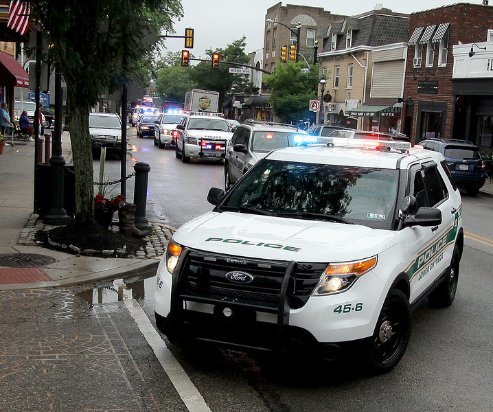 Bob Raines--Montgomery Media<br /> A cortege of police vehicles from area departments accompany Sgt. William Frank on his last ride to the Ambler Borough building where he was honored for his 26 years of service June 18, 2015.<br /> Bob Raines--Montgomery Media