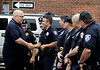 Officers from Ambler and other area police departments congratulate Sgt. William Frank at the Ambler Borough Hall following his ceremonial last ride through town June 18, 2015 as he ends 26 years of service.<br /> Bob Raines--Montgomery Media