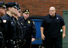 Brother officers from area police departments stand to attention as Sgt. William Frank, right, arrives at the Ambler Borough building following his ceremonial his last ride. He is accompanied by Ambler's Chief William Foley.<br /> Bob Raines--Montgomery Media