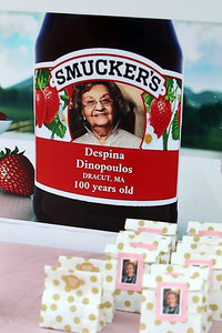 Participants in drive-by parade past the home of Dot Dinopoulos of Dracut received small bags of Smucker's to celebrate her 100th birthday. (SUN/Julia Malakie)
