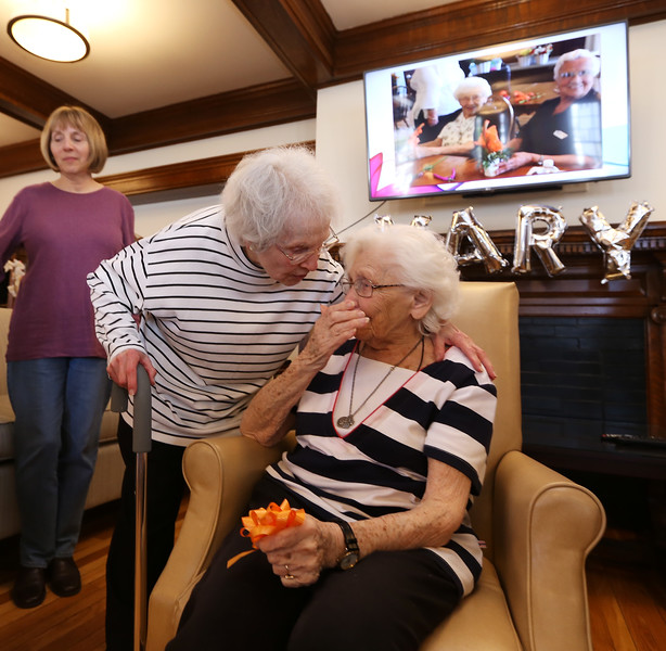 Rogers Hall resident Mary Dudek of Lowell celebrates her 103rd birthday. Her actual birthday was March 20. Mary Dudek, right, with her friend of 70 years, Helen Buczek of Lowell. Mary was Helen's maid of honor, and godmother to Helen's daughter Ann Marie Buczek of Lowell, left. (SUN/Julia Malakie)