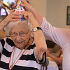 Rogers Hall resident Mary Dudek of Lowell celebrates her 103rd birthday. Her actual birthday was March 20. Rogers Hall property manager Marguerite Marcotte of Andover gets Dudek to put on a party hat. (SUN/Julia Malakie)