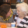 Rogers Hall resident Mary Dudek of Lowell celebrates her 103rd birthday. Her actual birthday was March 20. Dudek talks with Rogers Hall resident services coordinator Michelle Coppi of Tewksbury.  (SUN/Julia Malakie)