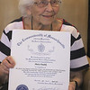 Rogers Hall resident Mary Dudek of Lowell received congratulations from the state legislature on her 103rd birthday. Her actual birthday was March 20.  (SUN/Julia Malakie)