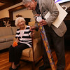 Rogers Hall resident Mary Dudek of Lowell celebrates her 103rd birthday. Her actual birthday was March 20. Rogers Hall past president Frank Faticanti of Lowell gives Mary Dudek a cane for her birthday. (SUN/Julia Malakie)