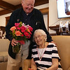 Rogers Hall resident Mary Dudek of Lowell celebrates her 103rd birthday. Her actual birthday was March 20. Bill Flanagan of Lowell, a member of the Rogers Hall board, presents Mary Dudek with flowers.  (SUN/Julia Malakie)