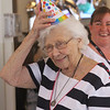 Rogers Hall resident Mary Dudek of Lowell celebrates her 103rd birthday. Her actual birthday was March 20. Rogers Hall property manager Marguerite Marcotte of Andover, right, watches Dudek put on a party hat. (SUN/Julia Malakie)