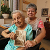 Lillian Pratte, who lives at Willow Manor in Lowell, will celebrate her 105th birthday on the Fourth of July. She and daughter Pat Van Lenten of Laconia hold a 1952 photo of themselves. (SUN/Julia Malakie)