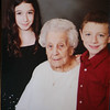 Lillian Pratte, who lives at Willow Manor in Lowell, will celebrate her 105th birthday on the Fourth of July. Pratte with great-grandchildren Melissa DeBonte and Michael DeBonte, Christmas 2008. (Courtesy photo)