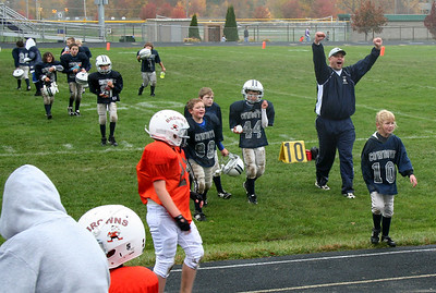 24OCT09   15 Minutes:  Coach Jeff Griffith and the Vermilion Cowboys celebrate a championship win and winning philosophy.  photo by SCOTT DEMOS   input by Chuck Humel