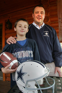 28OCT09  15 Minutes Vermilion Cowboys head coach Jeff Griffith and qb son Jaret, 9.    web site for anyone interested is www.vermilionyouthtackleleague.com   link broken but google search turned up http://www.leaguelineup.com/welcome.asp?url=vermilionyouthfootball    photo by Chuck Humel