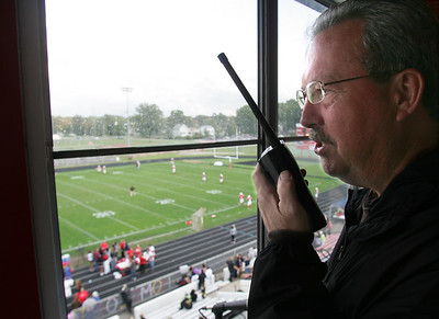2OCT09  15 minutes Greg Horace Pioneer announcer, former principal and ftball coach checks the public address system before a game.  photo by Chuck Humel