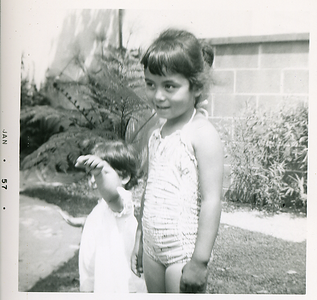 1957-01-mich-n-kathie-in-the-backyard
