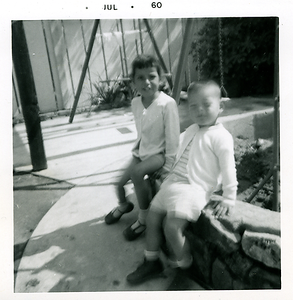 1960-07-michaela-n-joe-by-the-swings